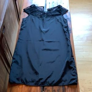 Black satin and sheer lace cocktail dress.